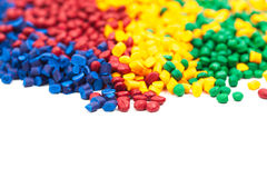 Het gekleurde plastiek korrelt stock afbeelding
