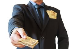 Het geld Braziliaan van de bedrijfsmensenholding in zijn handen en in kostuumzak Witte achtergrond stock afbeelding