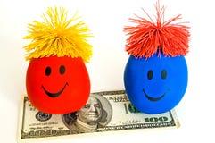 Het geld brengt Kleurrijke Glimlachen! Royalty-vrije Stock Foto's