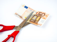Het geld van de besnoeiing Stock Fotografie