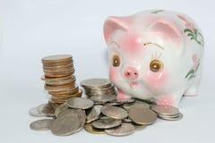 Het geld van de besparing Stock Foto's