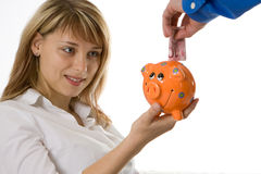 Het Geld van de besparing in een Spaarvarken Royalty-vrije Stock Foto's