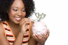 Het Geld van de Besparing van de vrouw Stock Fotografie