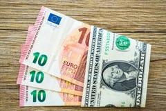 Het geld van de euro en van de dollar stock afbeeldingen