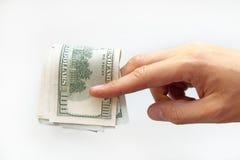 Het geld van de handholding - de dollars van Verenigde Staten Stock Afbeeldingen