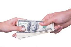 Het geld van de handoverdracht Stock Afbeeldingen