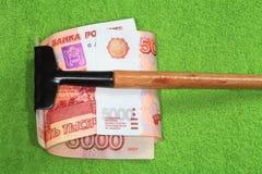 Het geld van de hark. Stock Foto