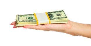 Het Geld van de Holding van de hand van de vrouw Royalty-vrije Stock Foto