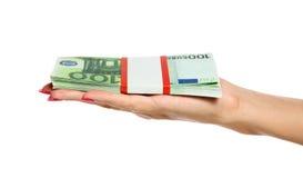 Het Geld van de Holding van de hand van de vrouw stock afbeelding