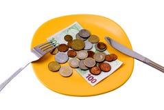 Het geld van de plaat Stock Foto