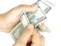 Het geld van de telling Stock Foto's