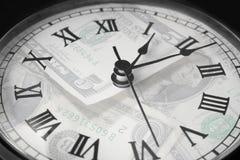 Het Geld van de tijd stock afbeelding
