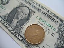 Het geld van de V.S. en van Canada Stock Foto