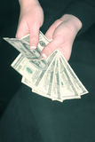 Het geld van de vrouw stock afbeeldingen
