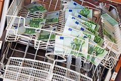Het geld van de was stock foto