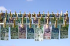 Het geld van de wasserij Stock Afbeeldingen