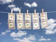 Het geld van de wasserij Royalty-vrije Stock Afbeeldingen