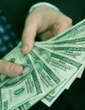 Het geld van de zakenman stock fotografie