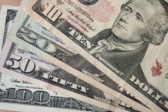 Het geld van dollars Stock Afbeeldingen