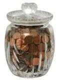 Het Geld van het muntstuk in een Kruik van het Glas stock foto's