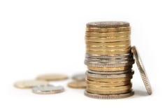 Het geld van het muntstuk in geïsoleerden stapels Royalty-vrije Stock Foto