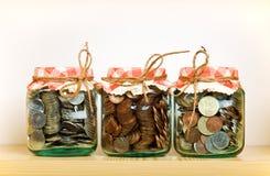 Het geldconcept van de besparing Stock Foto's