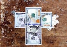 Het geldkruis van dollarrekeningen Royalty-vrije Stock Foto's