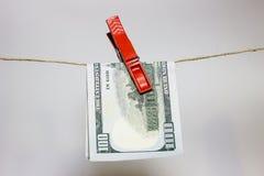 het geldwasserij van het 100 dollarsbankbiljet Stock Foto