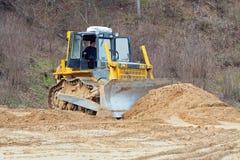 Het gele bulldozer werken Stock Afbeelding
