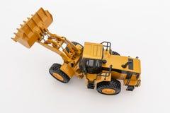 Het gele model van de wiellader stock afbeelding