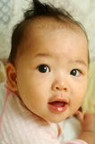 Het gelukkige baby glimlachen Stock Afbeelding
