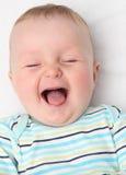 Het gelukkige baby lachen Royalty-vrije Stock Afbeelding