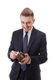 Het gelukkige bussinessman glimlachen hebbend een hoop van geld in zijn portefeuille Royalty-vrije Stock Fotografie
