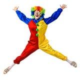 Het gelukkige clown springen Stock Afbeeldingen