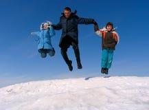 Het gelukkige familie springen Stock Afbeelding