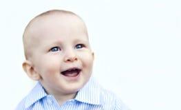 Het gelukkige gezicht van de babyjongen Stock Foto