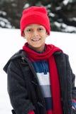 Het gelukkige Indische de jongen van het Oosten spelen in de sneeuw Royalty-vrije Stock Fotografie