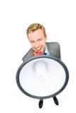 Het gelukkige jonge bussinessman schreeuwen met megafoon op wit Stock Foto's