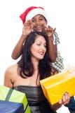 Het gelukkige jonge geitje en de vrouw met Kerstmis stellen voor Stock Fotografie