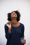 Het gelukkige jonge vrouw vieren Stock Fotografie