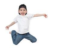 Het gelukkige jongen springen Stock Afbeelding