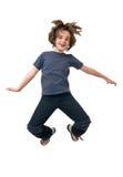 Het gelukkige kind springen Stock Foto