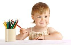 Het gelukkige kind trekt met rood kleurpotlood Stock Afbeelding