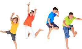 Het gelukkige kinderen springen Royalty-vrije Stock Fotografie