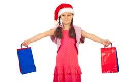 Het gelukkige meisje met Kerstmis stelt voor Stock Foto's
