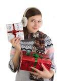 Het gelukkige meisje met Kerstmis stelt voor Stock Afbeelding