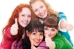 Het gelukkige meisjes tonen beduimelt omhoog Stock Afbeeldingen