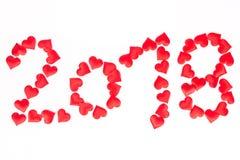 Het gelukkige nieuwe jaar van 2018, aantal met rode harten boven witte backgrou Stock Fotografie