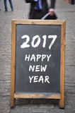 het gelukkige nieuwe jaar van 2017 op openluchtpaneel Royalty-vrije Stock Foto's