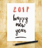 het gelukkige nieuwe jaar van 2017 op Witboekkader met potlood in hand bru Stock Foto